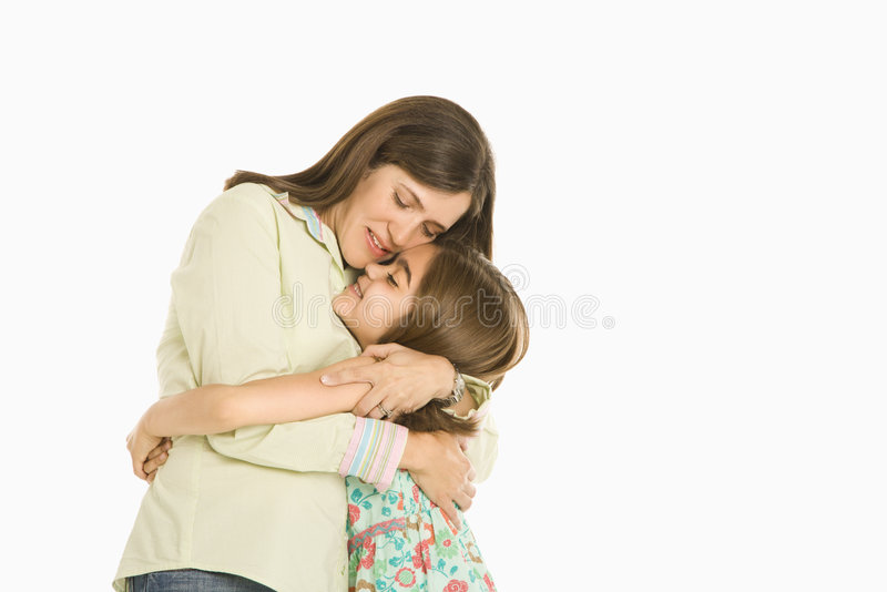 Mother and daughter hugging. stock photography
