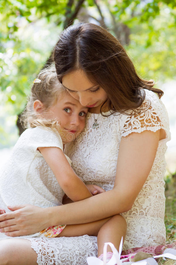 Mother and daughter hugging. Child safety concept stock image