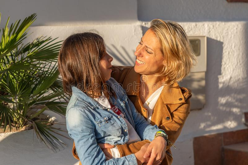 Mother and daughter hugging each other in mediterranean coastal town royalty free stock photos