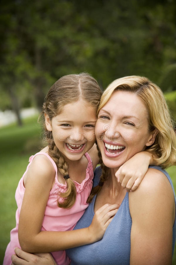 mother and daughter hugging and laughing outdoor royalty free stock photo