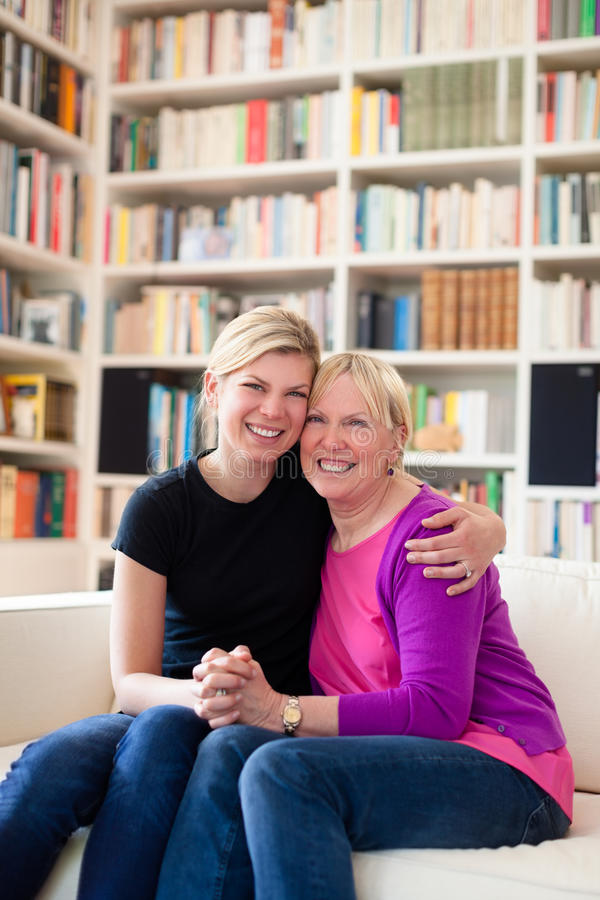 Mother And Daughter Hugging, Looking At Camera Royalty Free Stock Image
