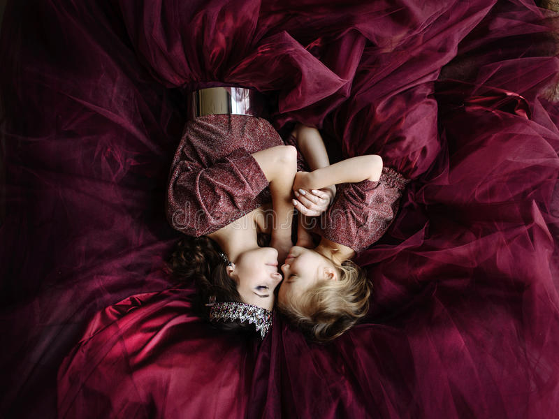 Mother and daughter in the image of the queen and princess dress stock images
