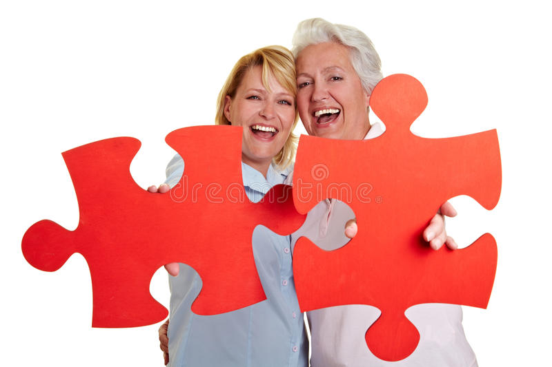 Mother and daughter with jigsaw stock image
