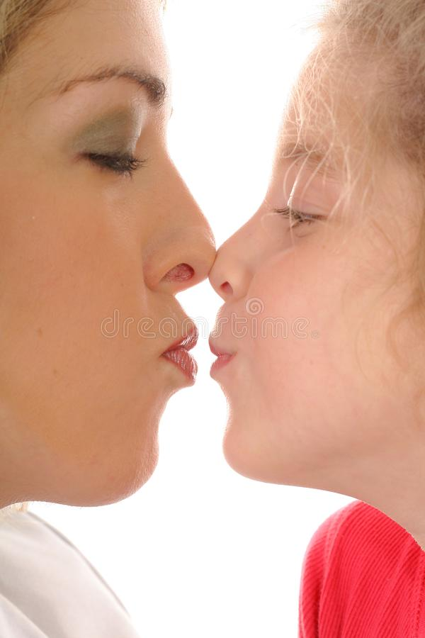 Mother & daughter kiss royalty free stock photography