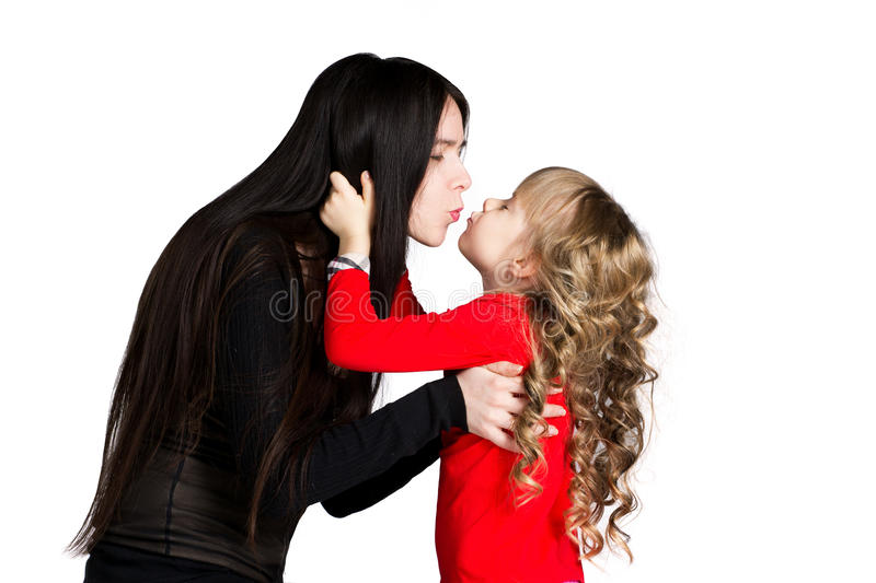Mother and daughter kissing royalty free stock image