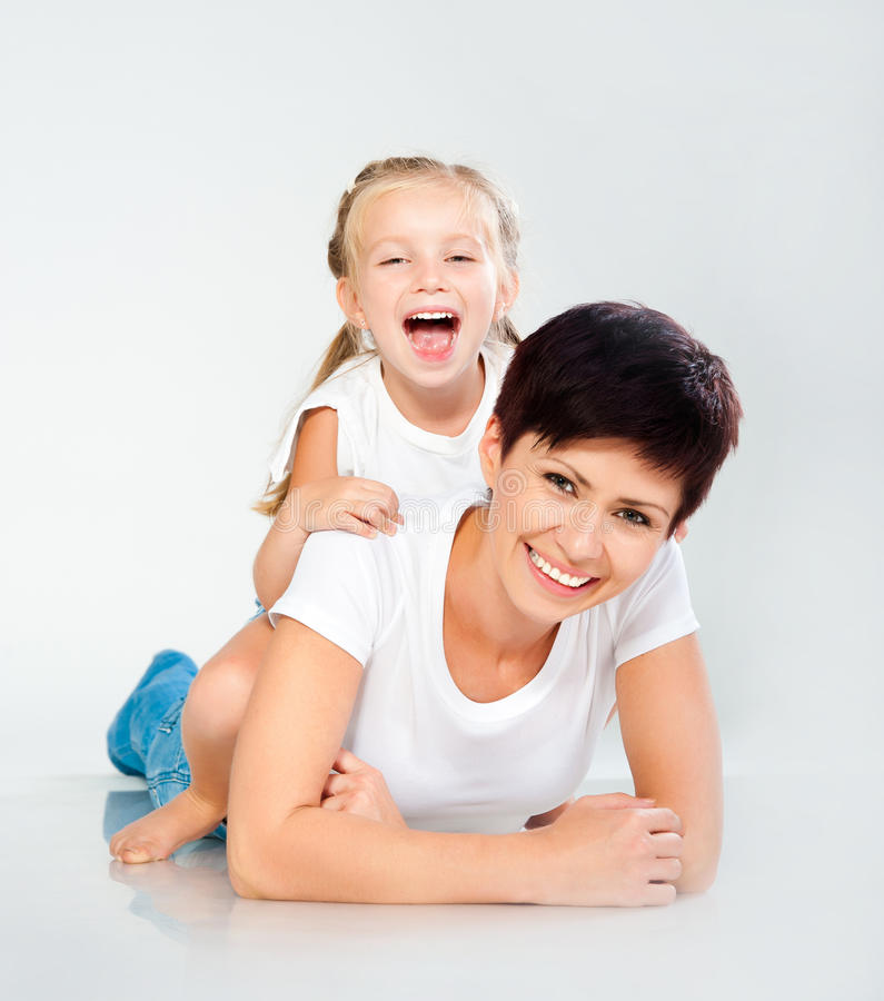 Mother and daughter laughing. And looking at camera stock photography