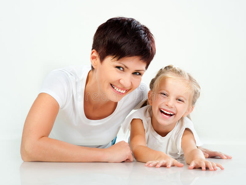 Mother and daughter laughing. And looking at camera stock images