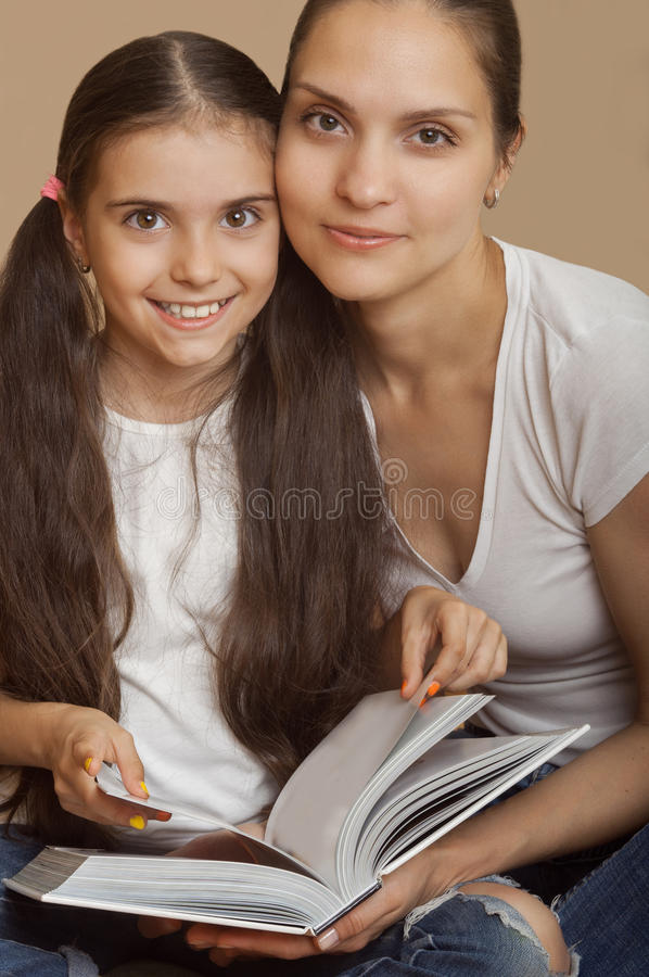 Mother and the daughter learn a lesson from the book royalty free stock images