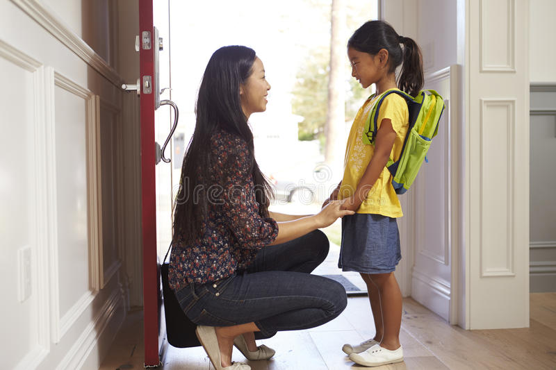 Mother And Daughter Leaving Home For School stock photography