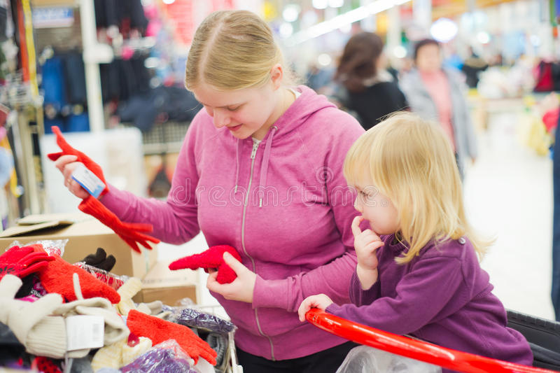 Download Mother And Daughter Look Gloves In Supermarket. Stock Image - Image: 23235403