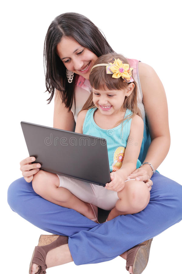 Mother and daughter looking at laptop stock photography