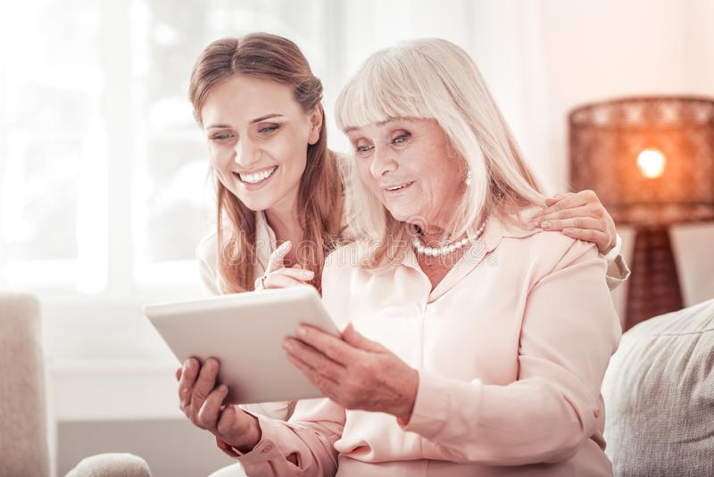 Mother and daughter looking at the photos in social media royalty free stock photo