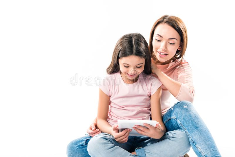 Mother and daughter looking at tablet stock photo