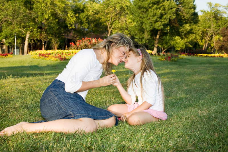 Mother and daughter love. Mother and daughter at the park stock photo