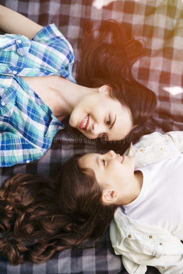 Download Mother And Daughter Are Lying Face To Face On Blanket And Looking At Each Other. Ther Are Looking At Each Othr And Stock Image - Image of baby, daughter: 120422949