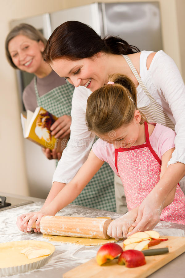 Mother and daughter making apple pie together royalty free stock photos