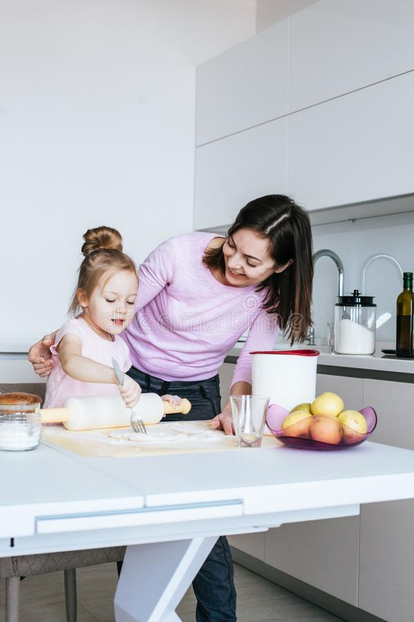 Mother And Daughter Making Cookies stock images