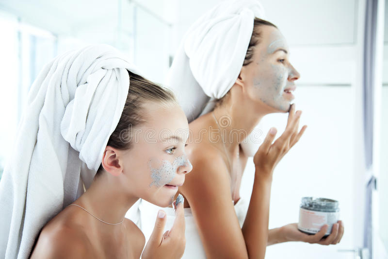 Mother and daughter making facial mask royalty free stock photography