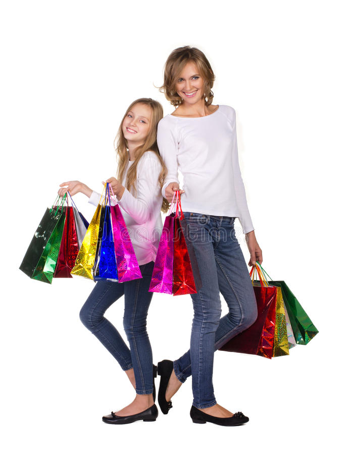 Mother and daughter with many bags stock images