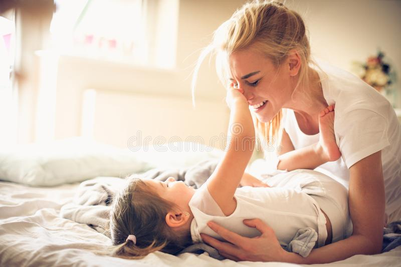 Mother and daughter at morning have playing. stock photography