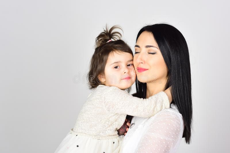 Mother and daughter. Mothers day. Childrens day. Happy woman with little girl. Beauty and fashion. Love and family royalty free stock images