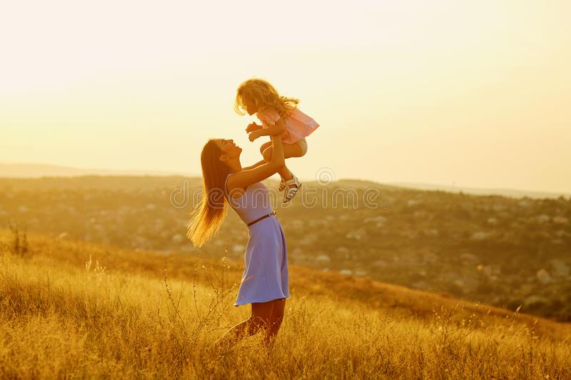 Mother and daughter in nature at sunset. Mothers Day royalty free stock photos