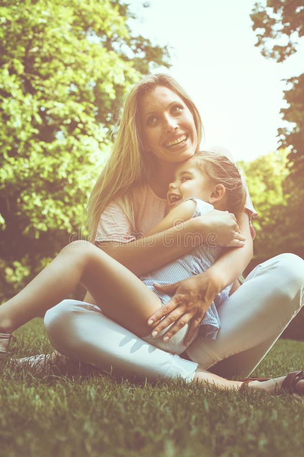 Mother and daughter outdoors in a meadow. Mother and daughter ha royalty free stock photos