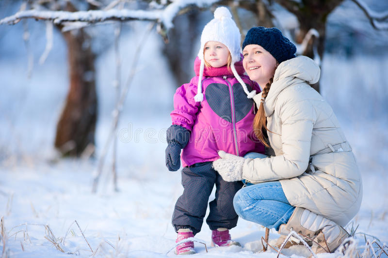 Mother And Daughter Outdoors At Winter Stock Photos
