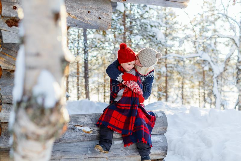 Mother and daughter outdoors on winter. Beautiful family of mother and her little daughter enjoying snowy winter day outdoors stock photo