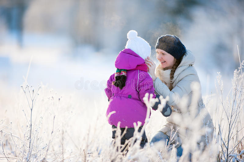 Download Mother And Daughter Outdoors On Winter Day Stock Photo - Image: 26477258