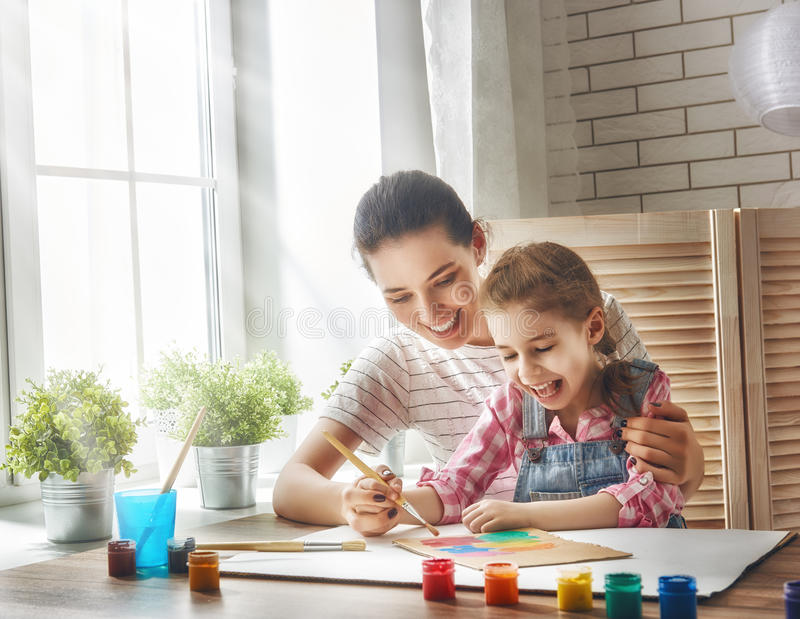 Mother and daughter paint stock photo