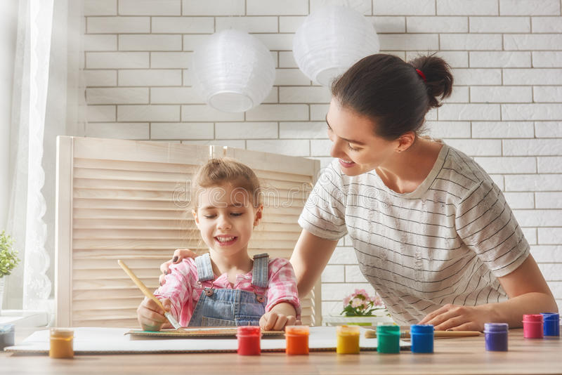 Mother and daughter paint royalty free stock image