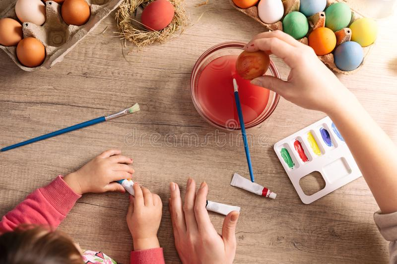 Mother and daughter are painting eggs royalty free stock image