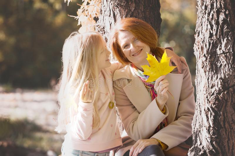 Mother and daughter in the park stock photography