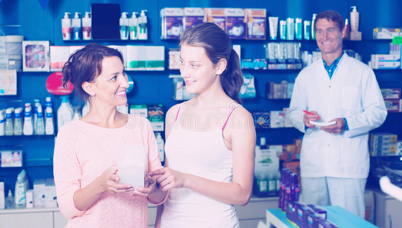 Mother with daughter in pharmacy royalty free stock photos