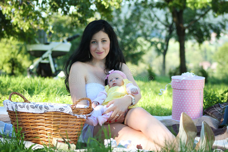 Mother and daughter picnic royalty free stock photography