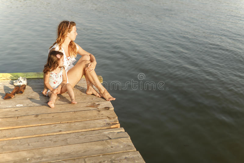 Mother and daughter on the pier royalty free stock image