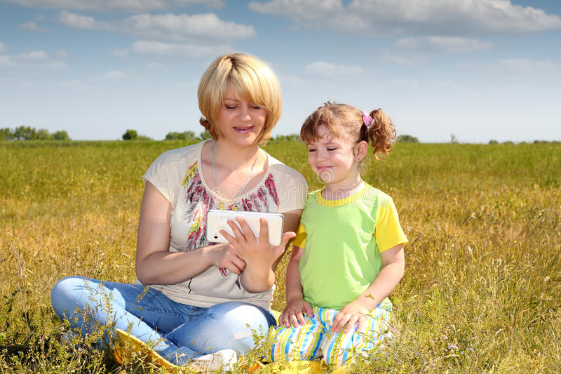 Mother And Daughter Playing Stock Images