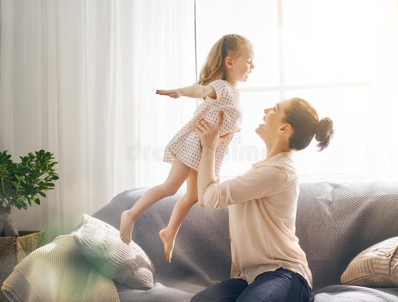 Mother and daughter playing royalty free stock photos