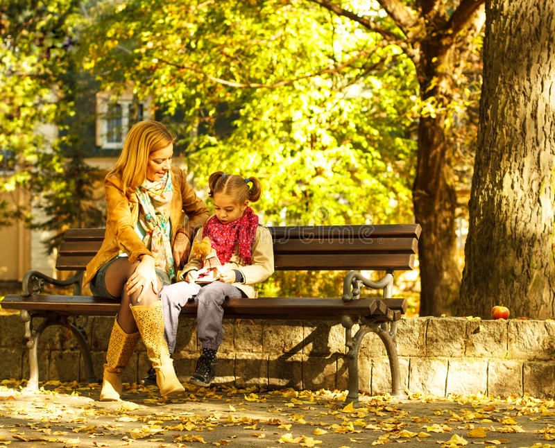 Mother and daughter playing in the park stock image