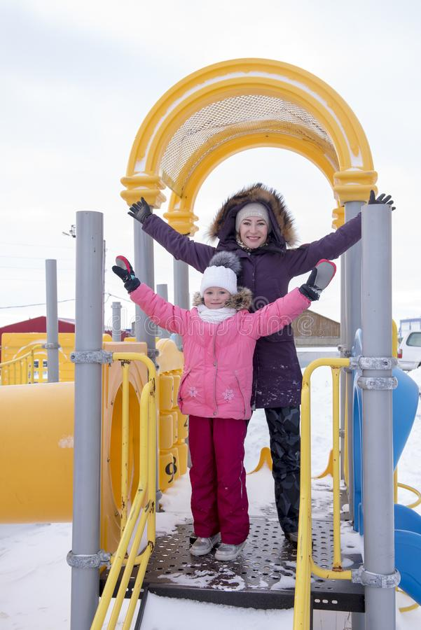 Mother and daughter on the playground royalty free stock photos