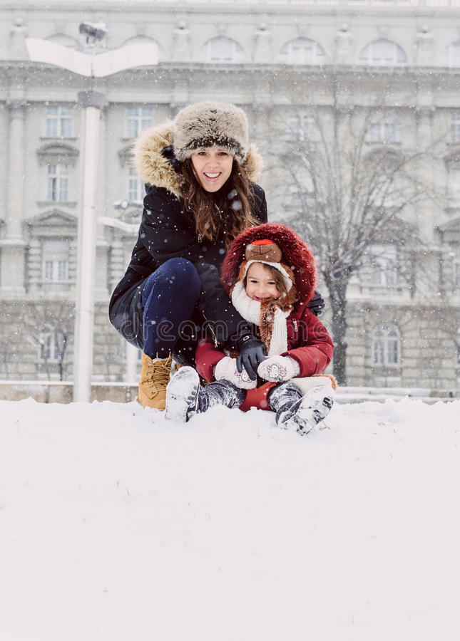 Mother and daughter. Playing on the snow royalty free stock photography