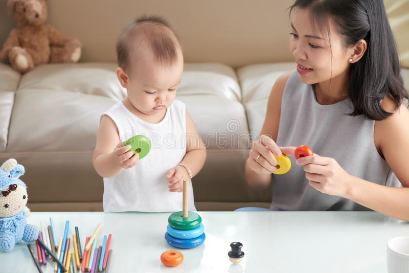 Mother and daughter playing together stock image