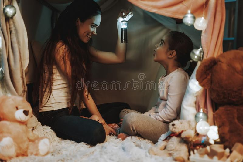 Mother and Daughter Playing Under the Fake Tent stock photo