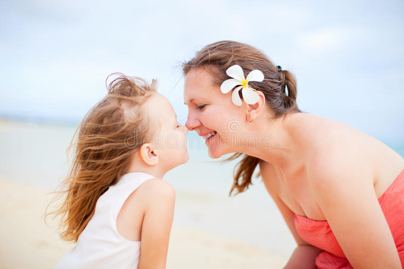 Mother and daughter portrait. Portrait of happy mother and her little daughter stock photos