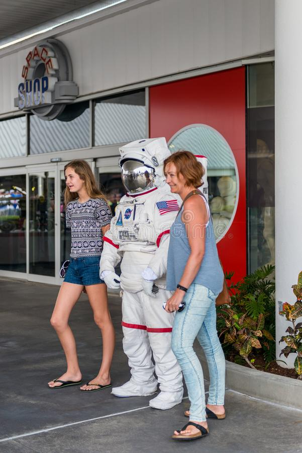 Mother and daughter posing with astronaut at Kennedy Space Center Visitor Complex in Cape Canaveral Florida USA. Mother and daughter have their picture taken royalty free stock image