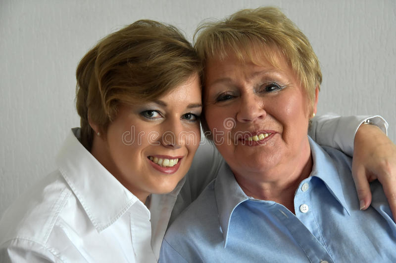 Mother and daughter. Posing for a photo royalty free stock photo