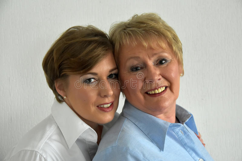 Mother and daughter. Posing for a photo stock photos