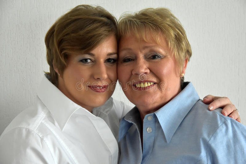 Mother and daughter. Posing for a photo royalty free stock images