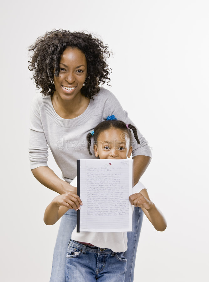 Mother and daughter posing with school report stock images